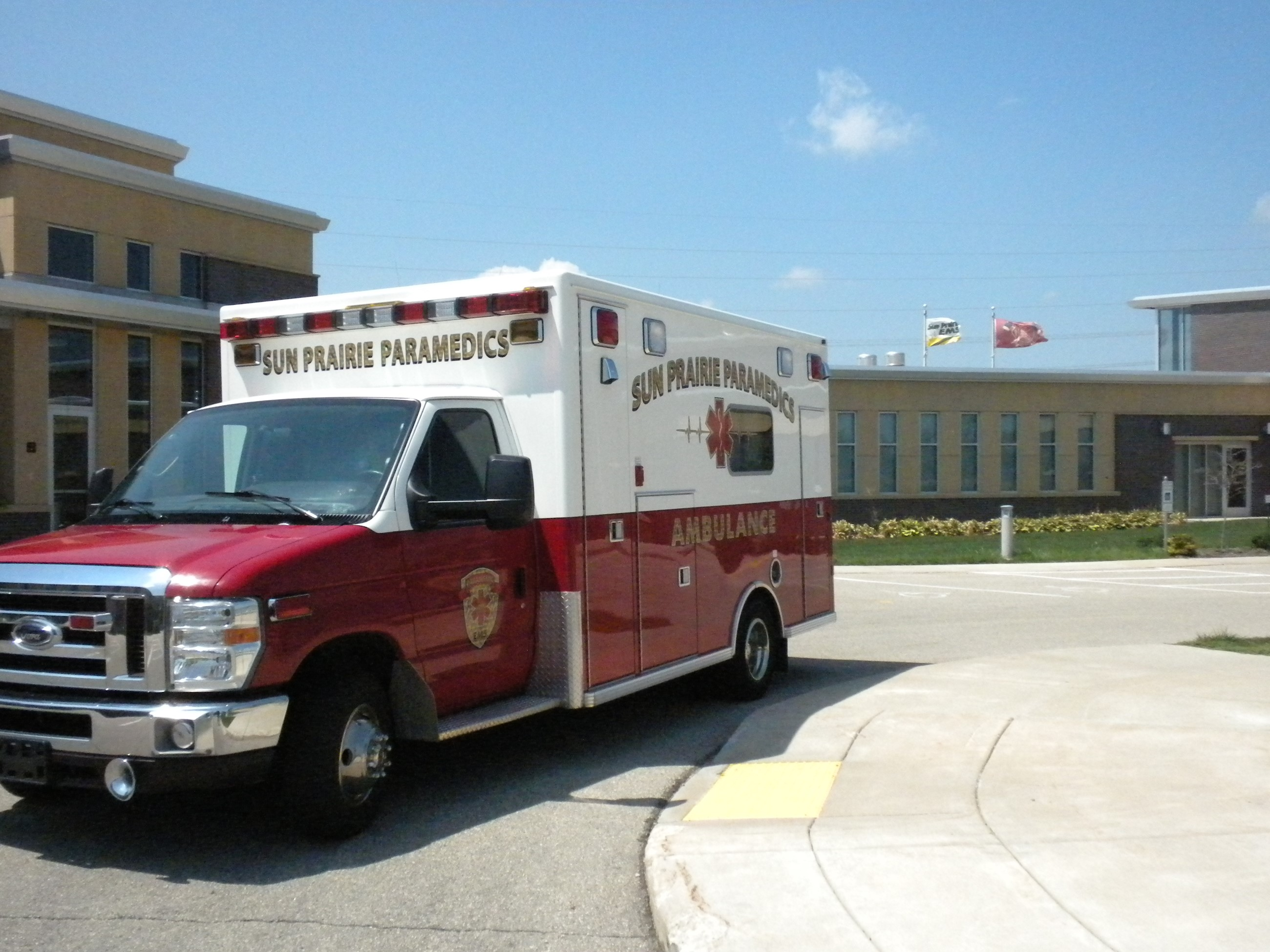 Photo of EMS Medic 72 ambulance parked outside Station 2 building