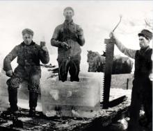 A black and white photo of 3 men harvesting ice around year 1910