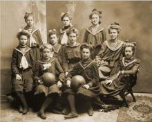 Black and white photo of girls basketball team from 1901