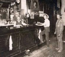 Black and white photo of men in a tavern