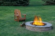 Outdoor fire properly contained within a fire pit