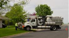 A Vacuum truck working in a city