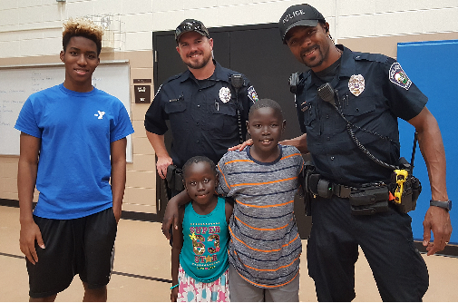Police Officers posing with kids