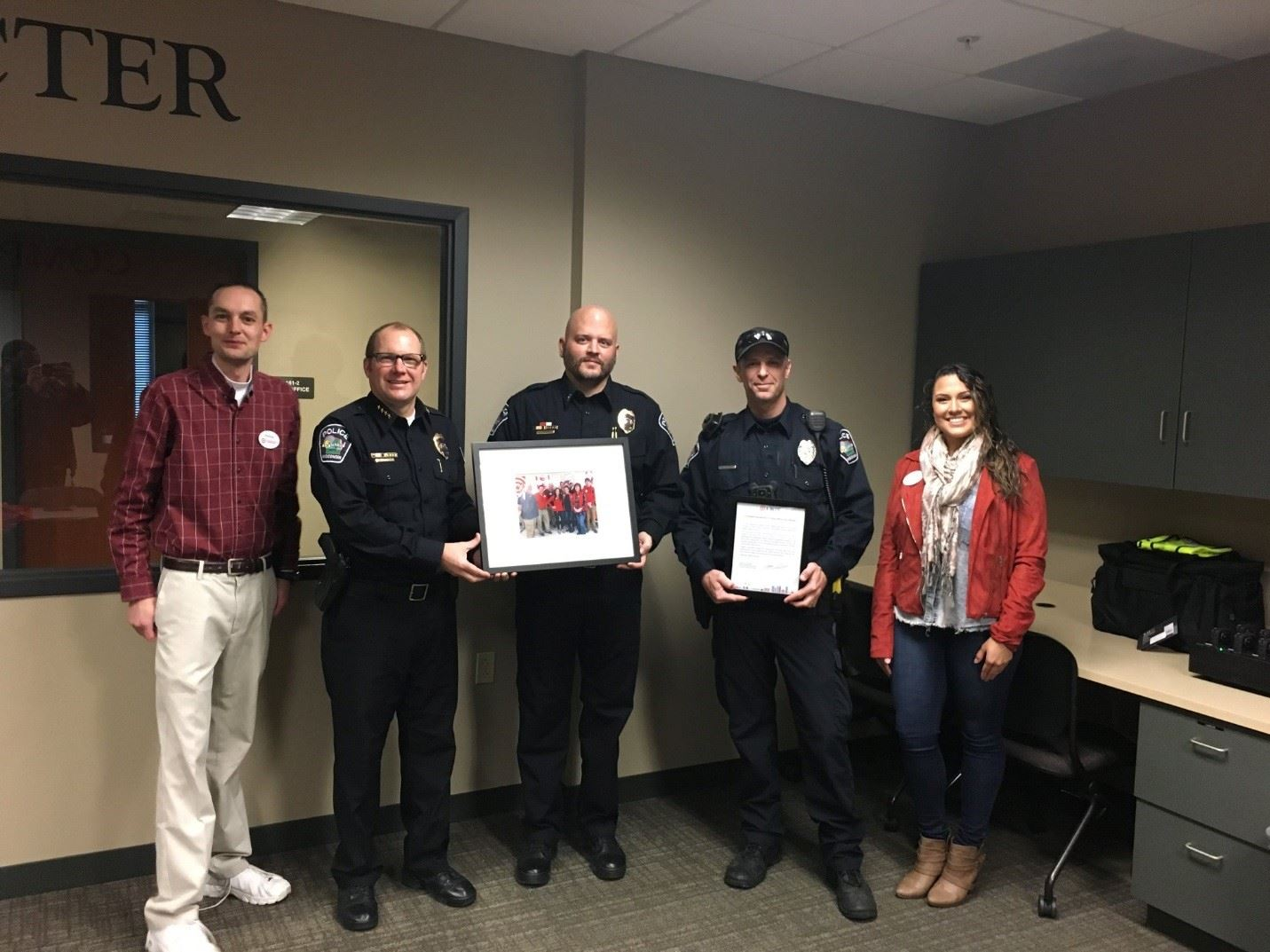 Officer Nichols with Target Employees holding a frame