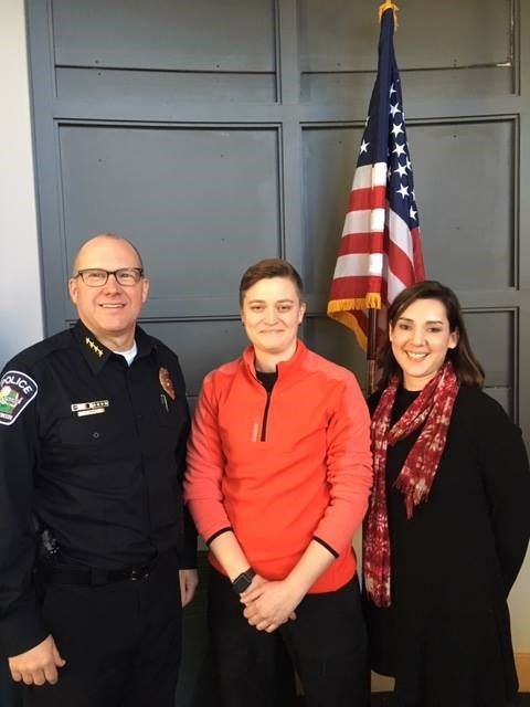 Officer Loni Broesch with Elene Hilby (right) and Chief Pat Anhalt (left).