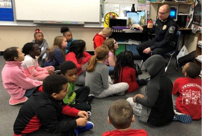 Chief Anhalt reading to students