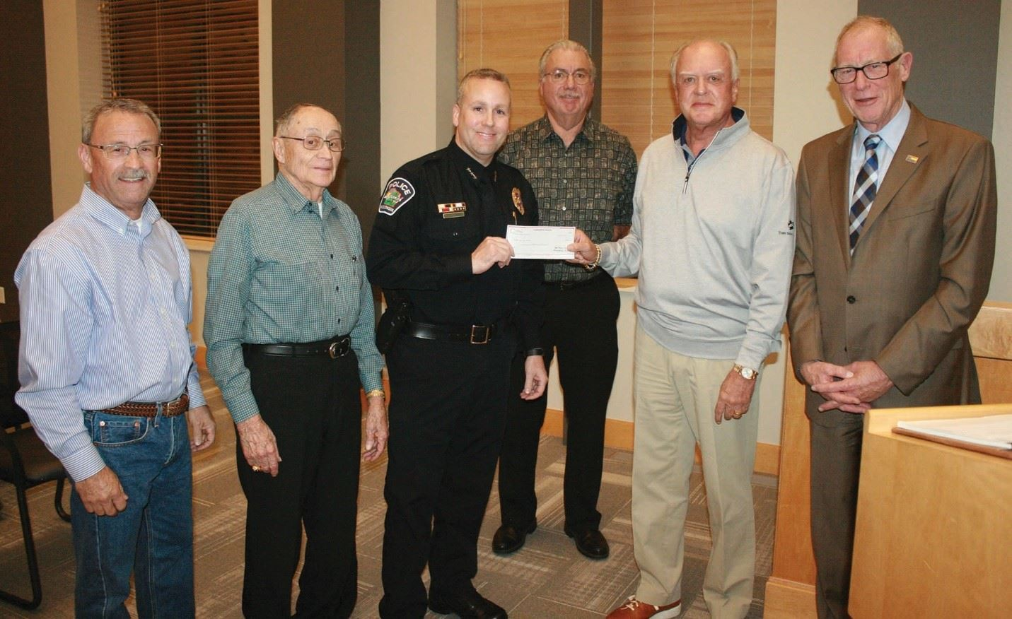 SPIC presenting check to Acting Chief Teasdale